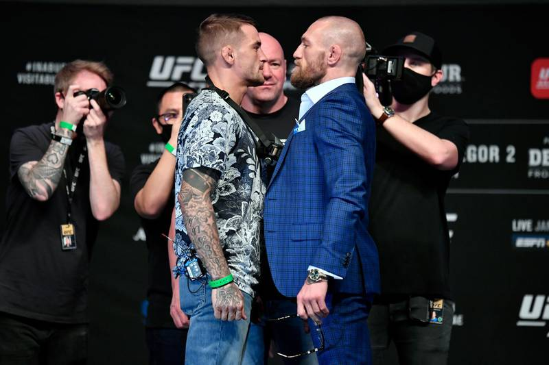 ABU DHABI, UNITED ARAB EMIRATES - JANUARY 21:  (L-R) Opponents Dustin Poirier and Conor McGregor pose face off for media during the UFC 257 press conference event inside Etihad Arena on UFC Fight Island on January 21, 2021 in Yas Island, Abu Dhabi, United Arab Emirates. (Photo by Jeff Bottari/Zuffa LLC via Getty Images)