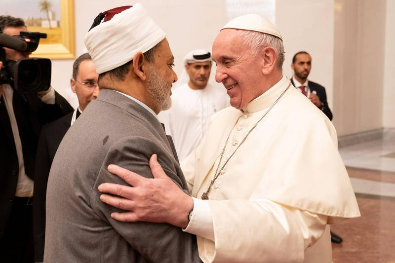 ABU DHABI, UNITED ARAB EMIRATES - February 3, 2019: Day one of the UAE Papal visit -  His Holiness Pope Francis, Head of the Catholic Church (R) greets His Eminence Dr Ahmad Al Tayyeb, Grand Imam of the Al Azhar Al Sharif (L), at the Presidential Airport.  ( Ryan Carter / Ministry of Presidential Affairs ) ---