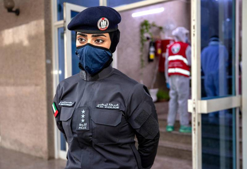 Abu Dhabi, United Arab Emirates, June 22, 2020.   STORY BRIEF: Police patrols knocking on doors offering free Covid-19 tests to residents in buildings in AD downtown, Al Bakra Street area.--  Captain Ayesha Al Mersad of the AUH Police.Victor Besa  / The NationalSection:  NAReporter:  Haneen Dajani