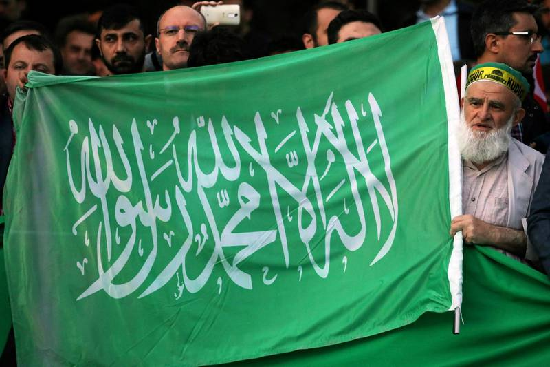 A protester chants slogans as he holds a Hamas flag outside the residence of the Israeli Ambassador in Ankara on May 14, 2018 during a demonstration against US President Donald Trump's decision to move the US embassy from Tel Aviv to Jerusalem. (Photo by ADEM ALTAN / AFP)