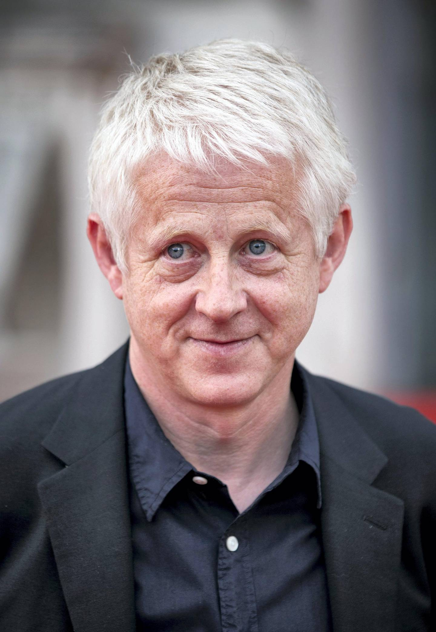 LONDON, UNITED KINGDOM - AUGUST 08: Richard Curtis attends the world premiere of 'About Time' at Somerset House on August 8, 2013 in London, England. (Photo by John Phillips/UK Press via Getty Images)