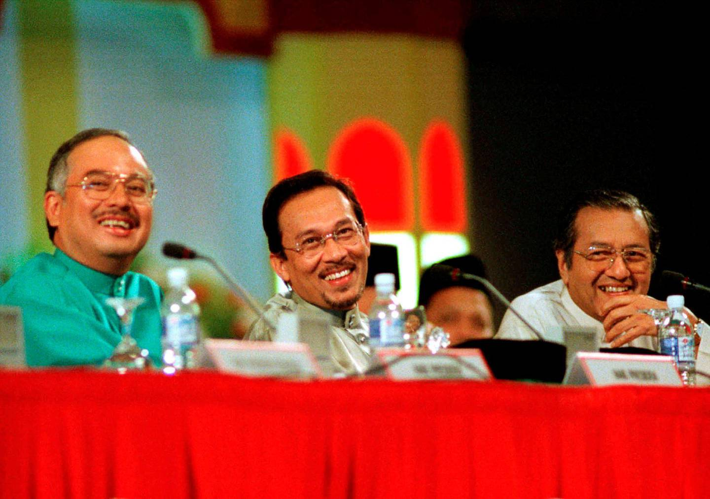 FILE PHOTO: Malaysia's Education Minister Najib Razak, Deputy Prime Minister Anwar Ibrahim and Prime Minister Mahathir Mohamad (L-R) laugh at a joke by one of the delegates during the United Malays National Organisation's (UMNO) annual general assembly in Kuala Lumpur, June 20, 1998. REUTERS/Stringer/File Photo
