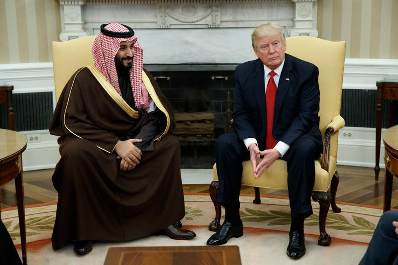 FILE - In this March 14, 2017, file photo, President Donald Trump meets with Saudi Defense Minister and Deputy Crown Prince Mohammed bin Salman in the Oval Office of the White House in Washington.  Trump wants to bring feuding Persian Gulf leaders to Camp David for a show of solidarity with the United States. But there are strings attached: No breakthrough in the Qatar crisis, no Camp David. A potential summit of the six-country Gulf Cooperation Council in May at the prestigious presidential retreat in Maryland's Catoctin Mountains will be scuttled unless Qatar and neighbors Saudi Arabia, the United Arab Emirates and Bahrain are on track to resolve the nearly year-long spat. A pair of Trump administration emissaries will deliver the message next week as they crisscross the Gulf in a renewed bid to try to end the crisis. The Saudi crown prince is expected to visit Washington in mid-March. (AP Photo/Evan Vucci, File)
