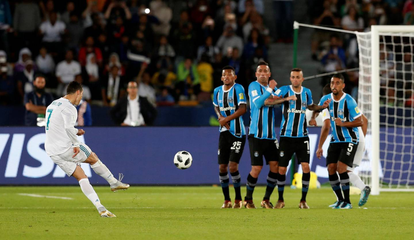 Soccer Football - FIFA Club World Cup Final - Real Madrid vs Gremio FBPA - Zayed Sports City Stadium, Abu Dhabi, United Arab Emirates - December 16, 2017   Real Madrid's Cristiano Ronaldo scores their first goal from a free kick   REUTERS/Matthew Childs