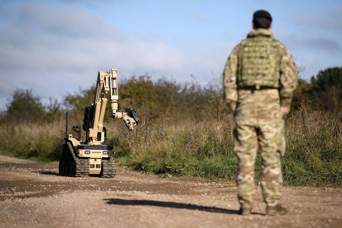 SALISBURY, ENGLAND - OCTOBER 15: A member of the Explosive Ordnance Disposal (EOD) search team looks on as a Harris T7 multi-mission robotic system is deployed during their Mission Rehearsal Exercise ahead of deployment to Mali, on the Ministry of Defence training area on Salisbury Plain, on October 15, 2020 in Salisbury, England. Later this year, 300 military personnel will join the UN in Mali on a peacekeeping mission and help counter instability following a coup which ousted President KevØta in August. The United Nations Multidimensional Integrated Stabilization Mission in Mali (MINUSMA) was formed in response to the seizing of territory by militant Islamists following a coup in 2012. The crisis in Mali has thrust 12.9 million into a precarious security situation, according to a UN estimate, with 6.8 million in need of humanitarian assistance. (Photo by Leon Neal/Getty Images)