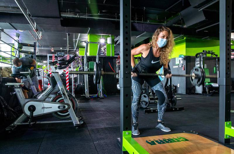 Abu Dhabi, United Arab Emirates, July 1, 2020.   Fitness buff, Natalie Navikova pumps some iron at Cobra Fitness Abu Dhabi at Al Bandar.Victor Besa  / The NationalSection:  NA Reporter:  Haneen Dajani