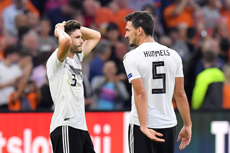 Germany's defender Jonas Hector (L) and Germany's defender Mats Hummels react at the end of the UEFA Nations League football match between Netherlands and Germany, on October 13, 2018 at Johan Crujiff ArenA in Amsterdam. / AFP / EMMANUEL DUNAND