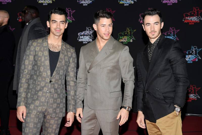 CANNES, FRANCE - NOVEMBER 09: (L-R) Joe Jonas, Nick Jonas and Kevin Jonas attend the 21st NRJ Music Awards at Palais des Festivals on November 09, 2019 in Cannes, France. (Photo by Pascal Le Segretain/Getty Images)