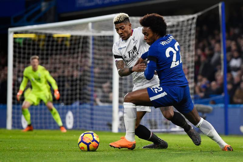 epa06594605 Chelsea's Willian (R) and Crystal Palace's Patrick van Aanholt (L) vie for the ball during the English Premier League soccer match Chelsea vs Crystal Palace at Stamford Bridge, London, Britain, 10 March 2018.  EPA/WILL OLIVER EDITORIAL USE ONLY. No use with unauthorized audio, video, data, fixture lists, club/league logos or 'live' services. Online in-match use limited to 75 images, no video emulation. No use in betting, games or single club/league/player publications