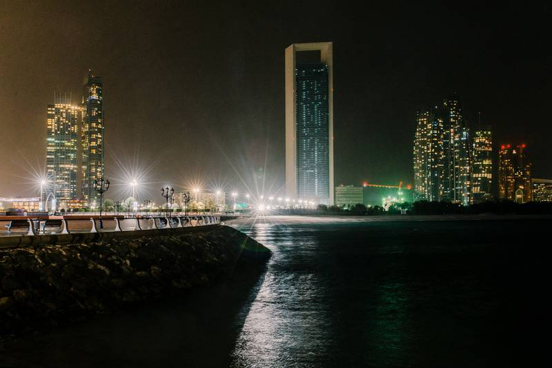Abu Dhabi, UAE. March 25th 2017. The ADNOC building (C) with its main lights off during Earth Hour 2017 when, between 20:30 and 21:30, a WWF initiative encrouages residents and businesses to turn off their lights. In Abu Dhabi, Earth Hour achieved mixed results, with many buildings along the skyline keeping their lights on. Alex Atack for The National.  *** Local Caption ***  250317_EarthHour-9.jpg