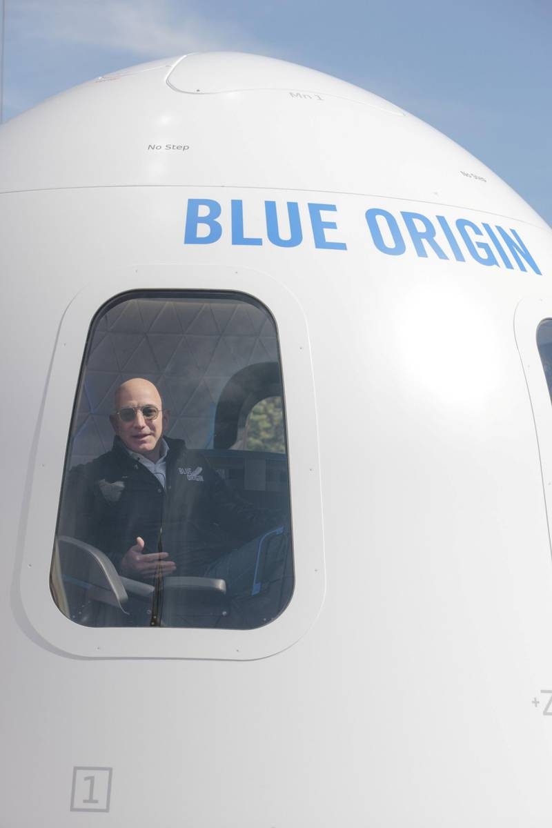Jeff Bezos, chief executive officer of Amazon.com Inc. and founder of Blue Origin LLC, sits inside the high fidelity crew capsule mock up of the Blue Origin New Shepard system during the Space Symposium in Colorado Springs, Colorado, U.S., on Wednesday, April 5, 2017. Bezos has been reinvesting money he made at Amazon since he started his space exploration company more than a decade ago, and has plans to launch paying tourists into space within two years. Photographer: Matthew Staver/Bloomberg