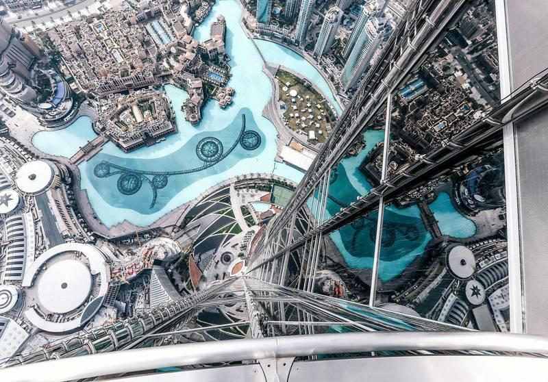 The Dubai Fountain and exterior of Burj Khalifa are seen from the 124th floor of the Burj Khalifa on February 8, 2017 in Dubai, United Arab Emirates. Photo by Jumana Jolie for Getty Images