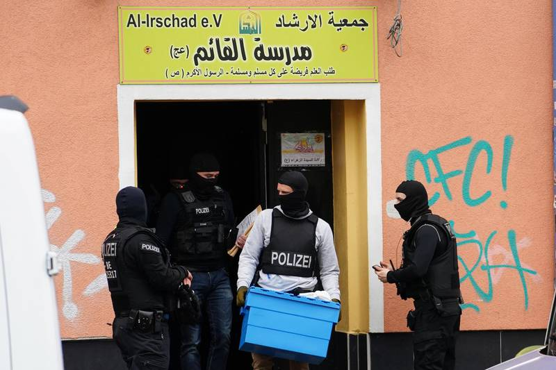 epa08392900 A police officer carrying a box walks out of a Al-Irschad association building during a raid in Berlin, Germany, 30 April 2020. The German Interior Ministry announced on the day that it has banned Iran-backed Hezbollah activity on German soil and designated it a terrorist organization. Police conducted early morning raids on mosque associations in several federal states, media reported.  EPA/CLEMENS BILAN