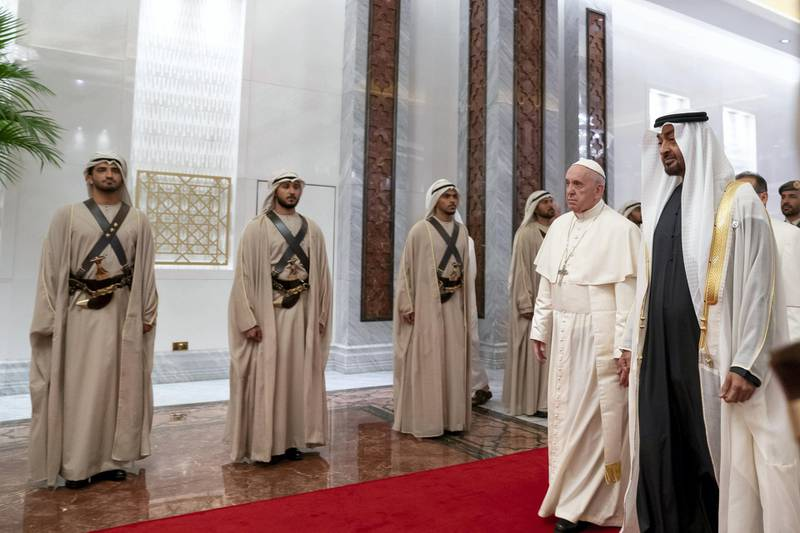 ABU DHABI, UNITED ARAB EMIRATES - February 3, 2019: Day one of the UAE papal visit - HH Sheikh Mohamed bin Zayed Al Nahyan, Crown Prince of Abu Dhabi and Deputy Supreme Commander of the UAE Armed Forces (R), receives His Holiness Pope Francis, Head of the Catholic Church (2nd R), at the Presidential Airport.  ( Mohamed Al Hammadi / Ministry of Presidential Affairs ) ---