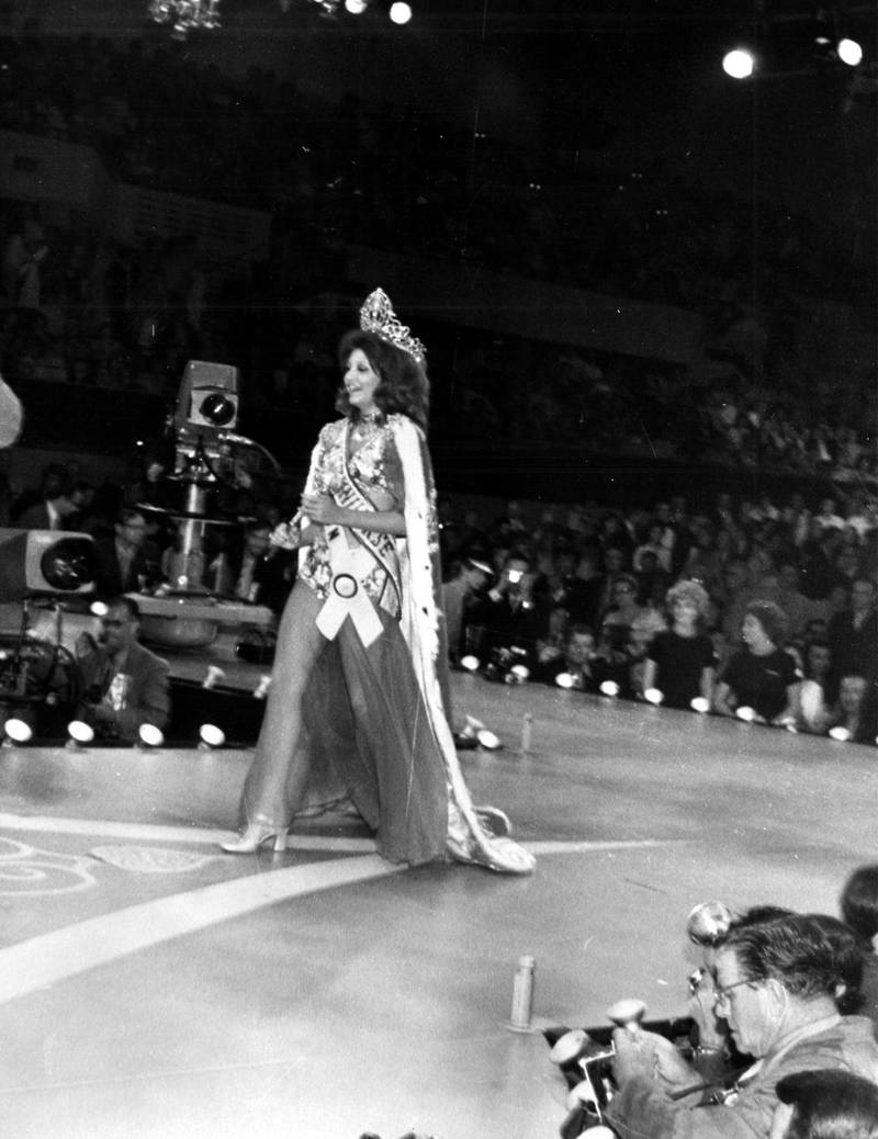 In the Miami Beach Auditorium and Convention Hall, Georgia Risk, Miss Lebanon, takes her first walk as Miss Universe 1971.  Risk was the first woman from her country to be named Miss Universe. Courtesy Miss Universe