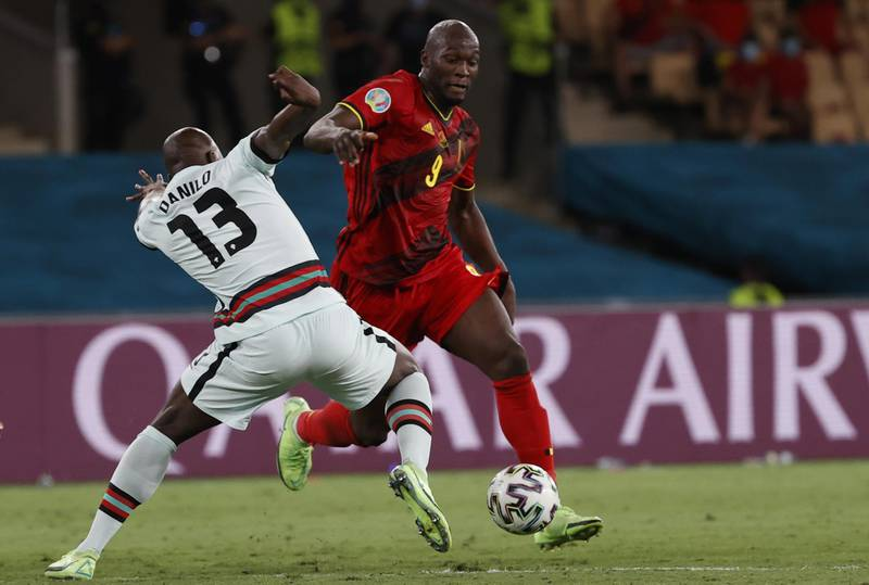 epa09306763 Danilo Pereira of Portugal in action against Romelu Lukaku (R) of Belgium during the UEFA EURO 2020 round of 16 soccer match between Belgium and Portugal in Seville, Spain, 27 June 2021.  EPA/Julio Munoz / POOL (RESTRICTIONS: For editorial news reporting purposes only. Images must appear as still images and must not emulate match action video footage. Photographs published in online publications shall have an interval of at least 20 seconds between the posting.)