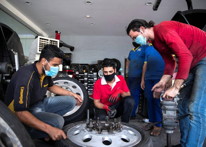 DUBAI, UNITED ARAB EMIRATES. 1 JUNE 2020. Epmloyees at Future Tyres Trading in Al Qouz.(Photo: Reem Mohammed/The National)Reporter:Section: