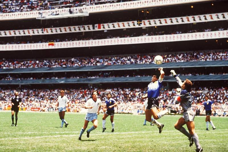 22 Jun 1986: Diego Maradona of Argentina handles the ball past Peter Shilton of England to score the opening goal of the World Cup Quarter Final at the Azteca Stadium in Mexico City, Mexico. Argentina won 2-1. FOTO:BONGARTS