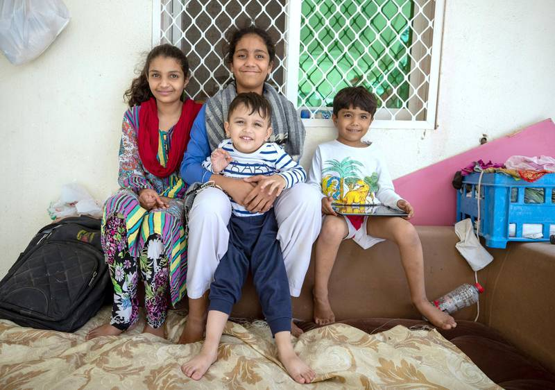 Sharjah, United Arab Emirates, March 1, 2020.  STORY BRIEF:  This is for a story about how parents are coping with the nursery shut down.  Abdullah Asad  (center)  with his cousins who help baby-sit, Sereet-12. Khadija-13,  and Ahmad-5.Victor Besa / The NationalSection:  NAReporter:  Ramola Talwar