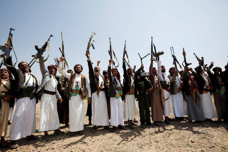 epaselect epa08618102 Armed supporters of the Houthi movement hold up their guns while shouting anti-Israel slogans during a protest against the peace agreement to establish diplomatic ties between Israel and the United Arab Emirates, in Sana'a, Yemen, 22 August 2020. Israel and the UAE reached an agreement to fully normalize relations. Many are against the agreement between the UAE and Israel, as they consider it breaks a consensus between Arab countries not to formalize diplomatic relations with Israel before the establishment of the Palestinian state.  EPA/YAHYA ARHAB