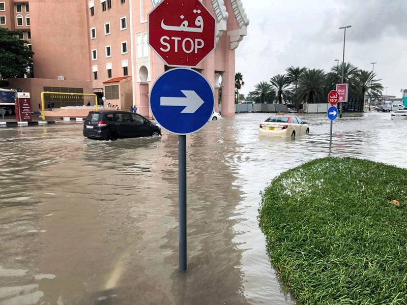 Dubai, United Arab Emirates, January 11, 2020. Water is logged outside the Movenpick Ibn Batutta Gate Hotel from heavy overnight rain. Several cars, including an RTA taxi, were waiting for pick-up trucks after breaking down in the water. James O'Hara / The National