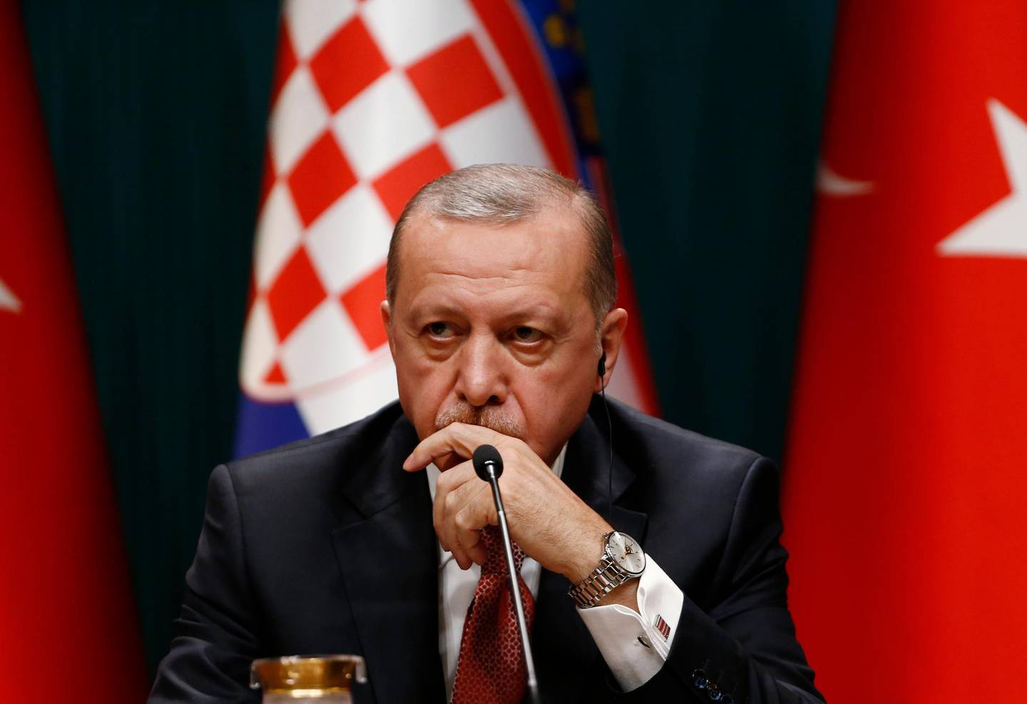 Turkey's President Recep Tayyip Erdogan talks during a joint news conference with Croatia's President Kolinda Grabar-Kitarovic, following their meeting at the Presidential Palace in Ankara, Turkey, Wednesday, Jan. 16, 2019. Erdogan said that an explosion that killed U.S. service members, during a routine patrol in the northern Syrian town of Manbij, may have been an act aimed to deter the United States from withdrawing troops. (AP Photo/Burhan Ozbilici)