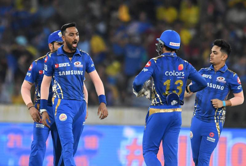 Mumbai Indians cricketer Krunal Pandya (L) celebrates with teammates after taking the wicket of Chennai Super Kings batsman Faf du Plessis during the 2019 Indian Premier League (IPL) Twenty20 final cricket match between Mumbai Indians and Chennai Super Kings at the Rajiv Gandhi International Cricket Stadium in Hyderabad on May 12, 2019. (Photo by NOAH SEELAM / AFP) / ----IMAGE RESTRICTED TO EDITORIAL USE - STRICTLY NO COMMERCIAL USE-----