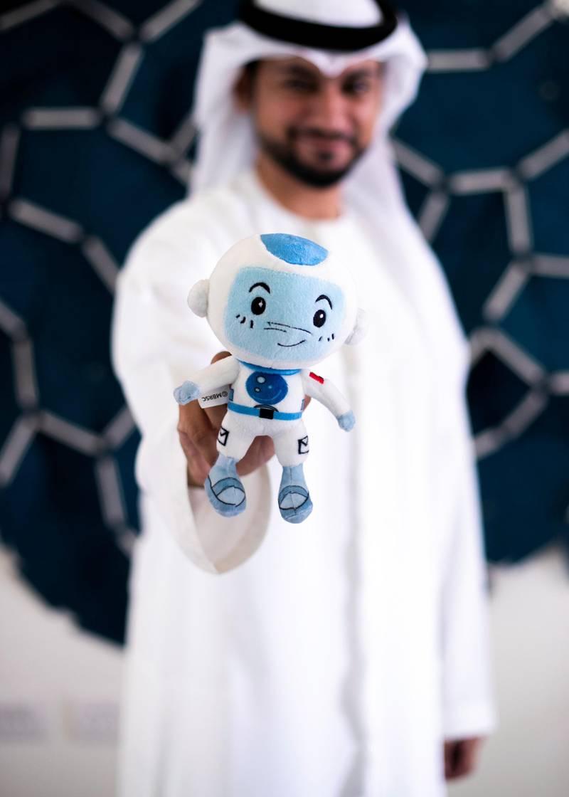 DUBAI, UNITED ARAB EMIRATES.  29 NOVEMBER 2020. Saeed Al Emadi holds Suhail, a stuffed toy mascot of the Mohammed Bin Rashid Space Centre (MBRSC). Suhail accompanied Emirati astronaut Hazza Al Mansoori on his space mission.(Photo: Reem Mohammed/The National)Reporter:Section: