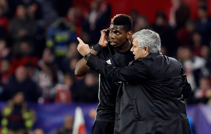 Manchester United manager Jose Mourinho, right, talks to Manchester United's Paul Pogba during the Champions League round of sixteen first leg soccer match between Sevilla FC and Manchester United at the Ramon Sanchez Pizjuan stadium in Seville, Spain, Wednesday, Feb. 21, 2018. (AP Photo/Miguel Morenatti)
