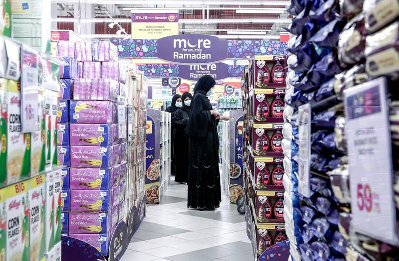 Abu Dhabi, United Arab Emirates, April 21, 2020.   Early Ramadan shoppers at Carrefour Yas Mall.  A lady checks out a Ramadan promotional stand.Victor Besa / The NationalSection:  NAFor:  Stock images
