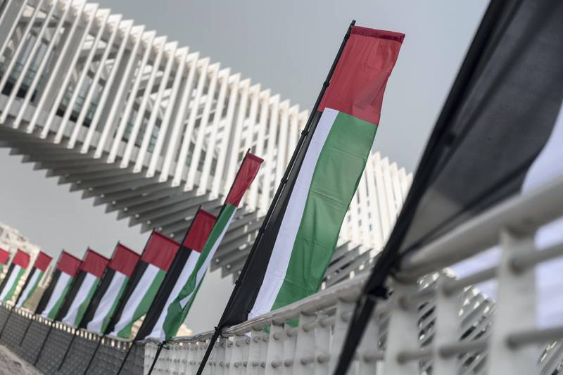 DUBAI, UNITED ARAB EMIRATES. 01 NOVEMBER 2017. UAE Flag day. UAE Flags line the new extension of the creek by the Al Wasl Rd bridge in Jumeirah. (Photo: Antonie Robertson/The National) Journalist: NONE. Section: National.
