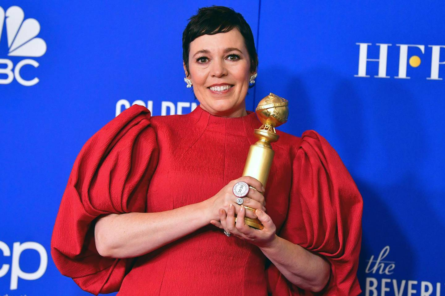 """TOPSHOT - British actress Olivia Colman poses in the press room with the award for Best Performance by an Actress In A Television Series - Drama for """"The Crown"""" during the 77th annual Golden Globe Awards on January 5, 2020, at The Beverly Hilton hotel in Beverly Hills, California. / AFP / FREDERIC J. BROWN"""