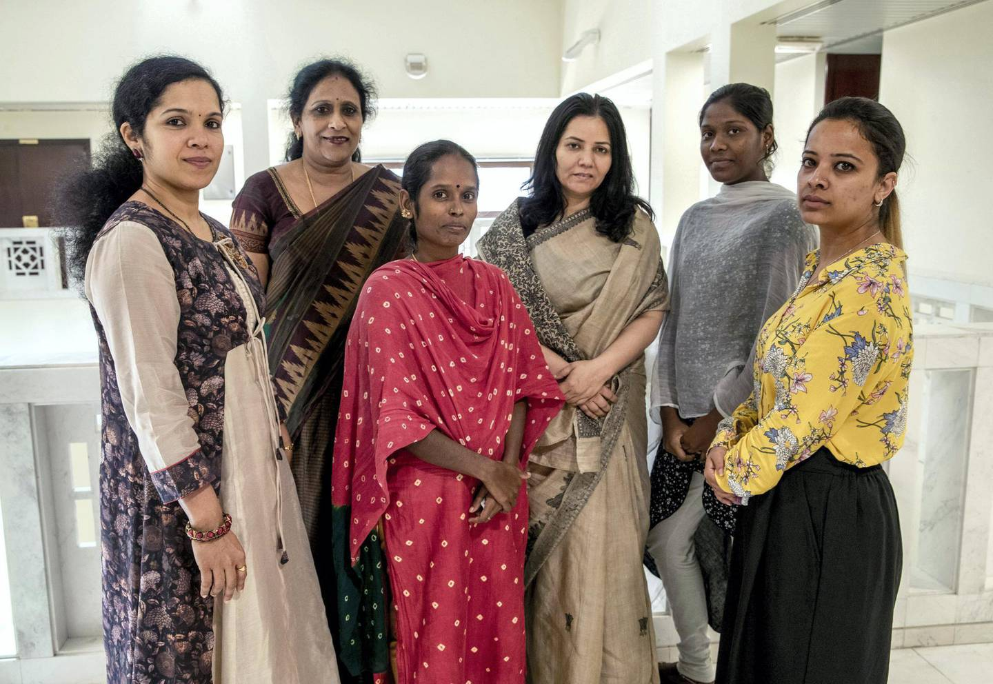 Abu Dhabi, United Arab Emirates, July 2, 2019.  This is for a runaway maids story. Veerammal Radhakishnanand ran away from an agent in Ajman and asked for help at the indian embassy.---  Embassy of India social workers helping domestic helpers in distress,  (center left) Veerammal Radhakrishnan and Lokeshwari Sudhakar. (2nd right)Victor Besa/The NationalSection:  NAReporter:  Ramola Talwar