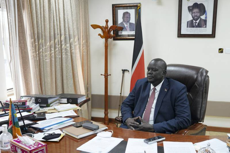 Honorable Deng Dau Deng Malek, Deputy Minister of Foreign Affairs, is posing for a photo in his office, in the Ministry of Foreign Affairs, in Juba, South Sudan, on June 21, 2021.
