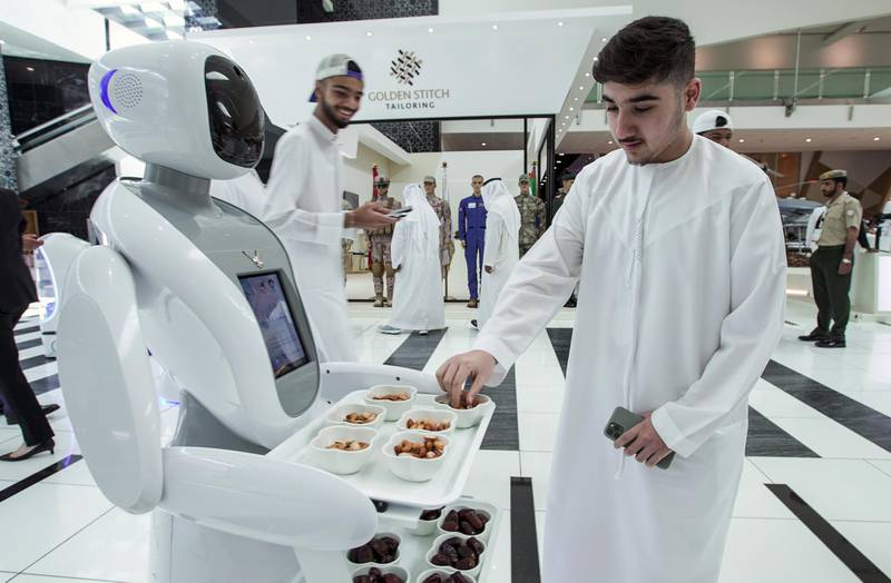 Abu Dhabi, United Arab Emirates, February 24, 2020.  The Unmanned Systems Exhibition and Conference (UMEX 2020) and Simulation Exhibition and Conference (SimTEX 2020).--  A UMEX 2020 robot welcomes guests with nuts and dates.Victor Besa / The NationalSection:  NAReporter:  None
