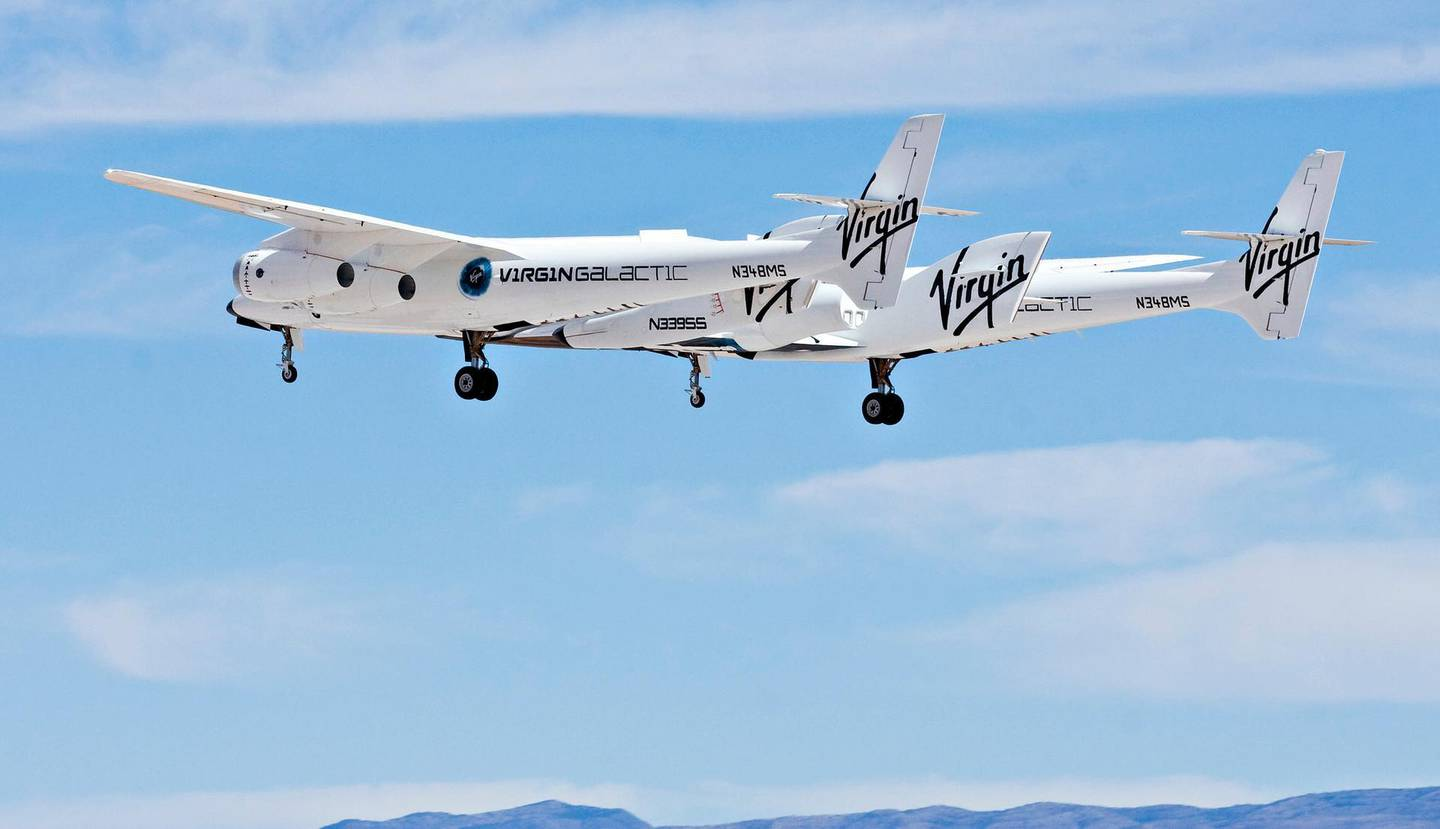 The WhiteKnightTwo mothership, carrying SpaceShipTwo, performs a flyover during an event commemorating the completion of the Virgin Galactic Spaceport America runway in Upham, New Mexico, U.S., on Friday, Oct. 22, 2010. Virgin Galactic plans to start test flights next year and will offer commercial space travel within five years, the Wall Street Journal reported in March. Photographer: Christ Chavez/Bloomberg