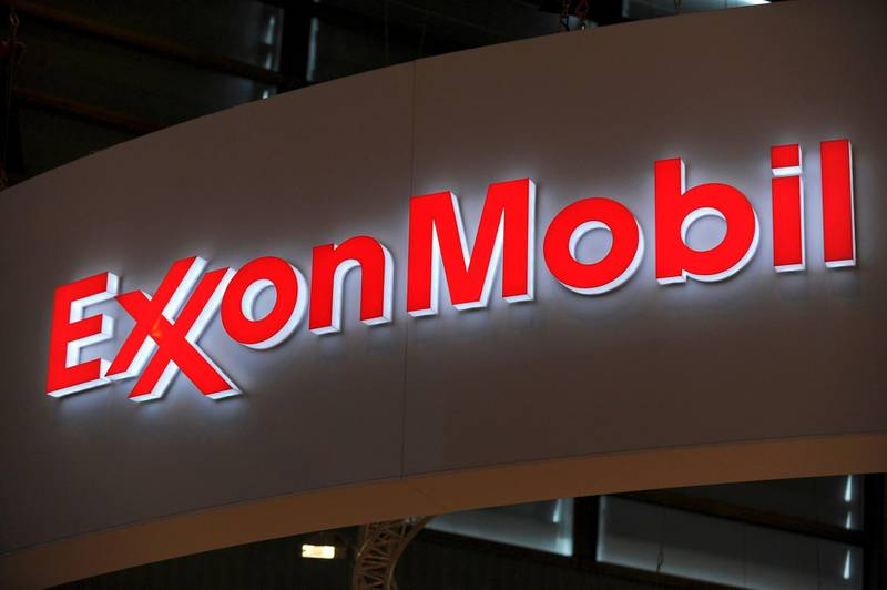 (FILES) In this file photo taken on June 02, 2015 a picture shows the logo of US oil and gas giant ExxonMobil during the World Gas Conference exhibition in Paris. ExxonMobil announced December 14, 2002 it will reduce its emissions over the next five years bowing to growing public pressure from activists, including the Church of England, to make changes.  / AFP / ERIC PIERMONT