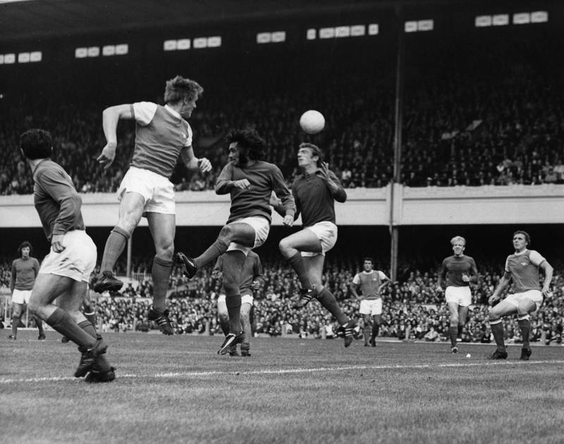 George Best of Manchester United leaps for a header near the United goalmouth during their match against Arsenal at Highbury Stadium on 22 August, 1970.   (Photo by Peter King/Getty Images)