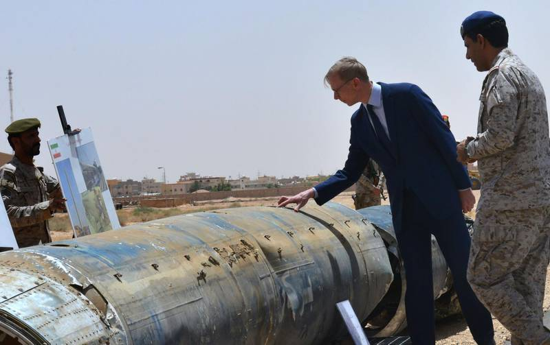 """Brian Hook (2nd R), the US special representative on Iran, checks what Saudi officials said were Iranian remnants of a """"cruise missile"""" that slammed into Abha airport on June 12, during a visit to an army base in al-Kharj, south of the Saudi capital Riyadh, on June 21, 2019. The US said Iran has no right to respond to diplomacy """"with military force"""", a day after Washington said Tehran shot down a US drone over the Strait of Hormuz. """"Our diplomacy does not give Iran the right to respond with military force,"""" Hook, told reporters in Saudi Arabia.  / AFP / Fayez Nureldine"""