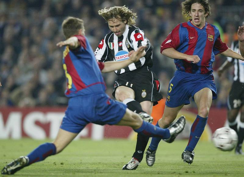 BARCELONA - APRIL 22:  Pavel Nedved of Juventus scores the first goal during the UEFA Champions League Quarter-Final second leg match between Barcelona and Juventus at the Nou Camp Stadium on April 22, 2003 in Barcelona, Spain. (Photo by Alex Livesey/Getty Images)
