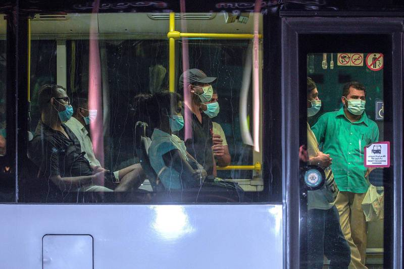 Abu Dhabi, United Arab Emirates, July 13, 2020.   Bus commuters at downtown Abu Dhabi heading home during rush hour.Victor Besa  / The NationalSection:  StandaloneReporter:
