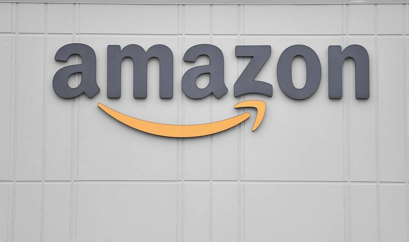 (FILES) This file photo taken on March 30, 2020 shows the logo of US online retail giant Amazon at the distribution center in Staten Island. US online retail giant Amazon broke into French soccer by sharing the broadcasting of Ligue 1 with Canal+, with an annual fee of 663 million euros for the clubs until 2024, a source close to the proceedings said, on June 11, 2021. / AFP / Angela Weiss