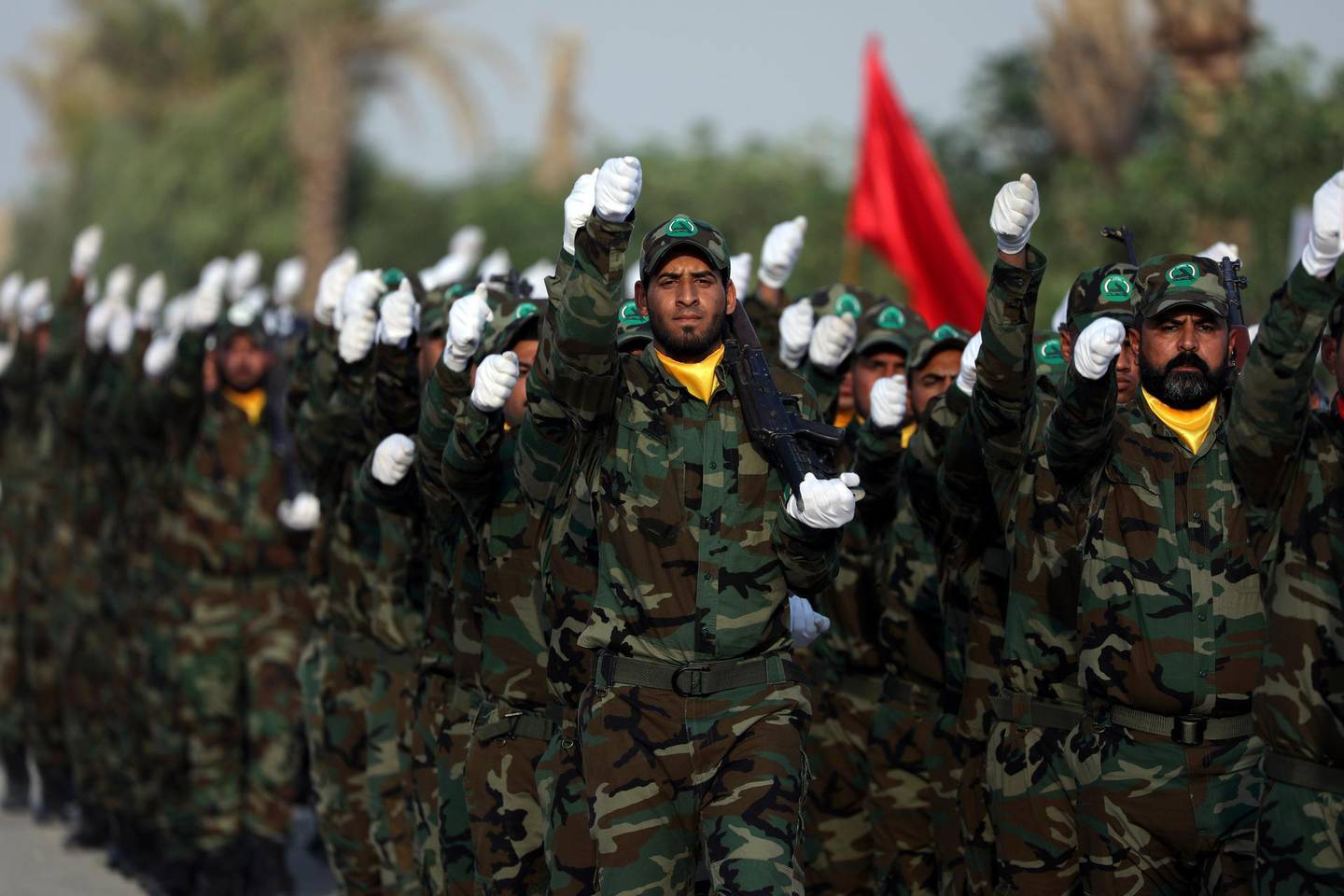 Members of the paramilitary Popular Mobilisation Forces (PMF) take part in their graduation ceremony at a military camp in Kerbala, Iraq August 30, 2019. REUTERS/Abdullah Dhiaa Al-Deen