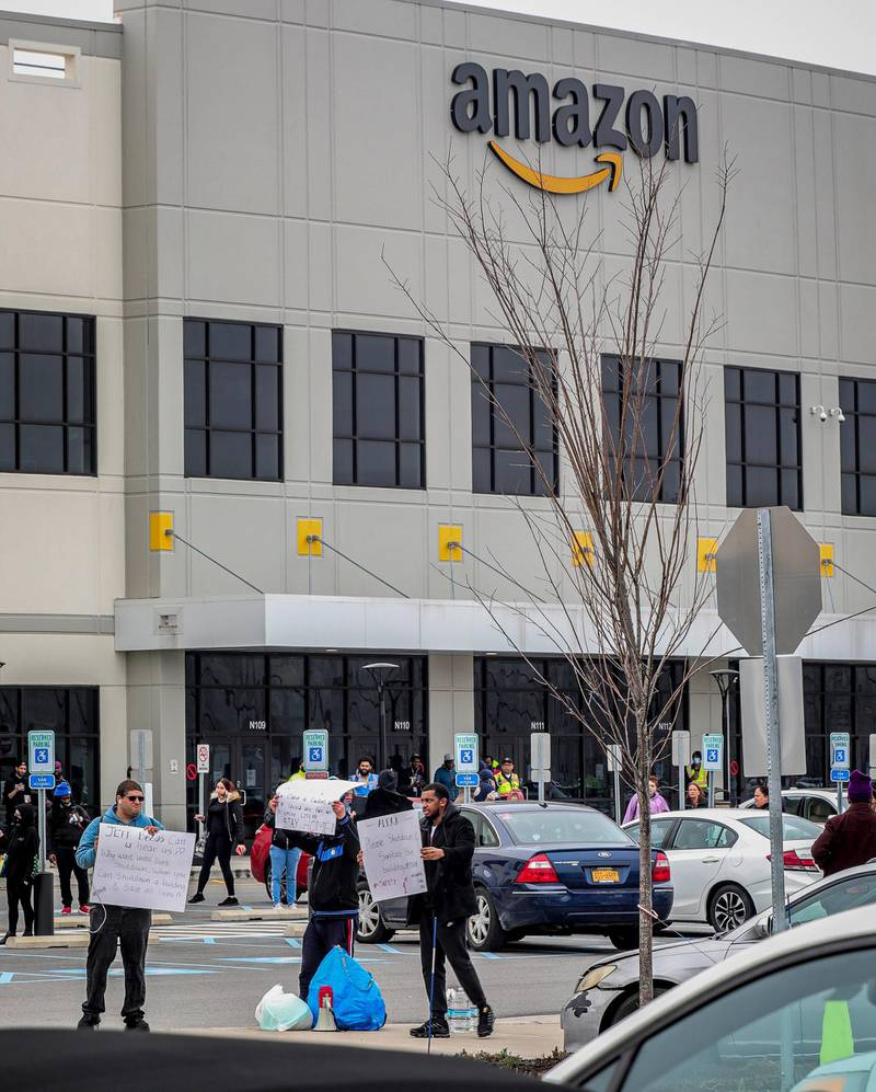 Workers at Amazon's fulfillment center in Staten Island, N.Y., protest work conditions in the company's warehouse, Monday March 30, 2020, in New York. Workers say Amazon is not doing enough to to keep workers safe from the spread of COVID-19 and coronavirus. (AP Photo/Bebeto Matthews)