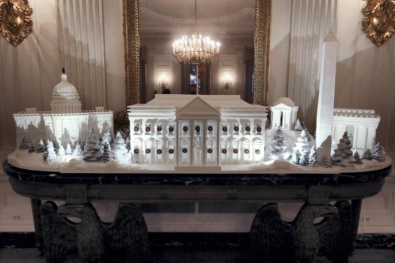 WASHINGTON, DC - NOVEMBER 26: Gingerbread buildings from the National Mall, including the Capitol, the Lincoln Memorial, the Jefferson Memorial, the Washington Monument, and the White House are on display in the State Dining Room at the White House November 26, 2018 in Washington, DC. The 2018 theme of the White House holiday decorations is 'American Treasures,' and features patriotic displays highlighting the country's 'unique heritage.' The White House expects to host 100 open houses and more than 30,000 guests who will tour the topiary trees, architectural models of major U.S. cities, the Gold Star family tree and national monuments in gingerbread. (Photo by Chip Somodevilla/Getty Images)
