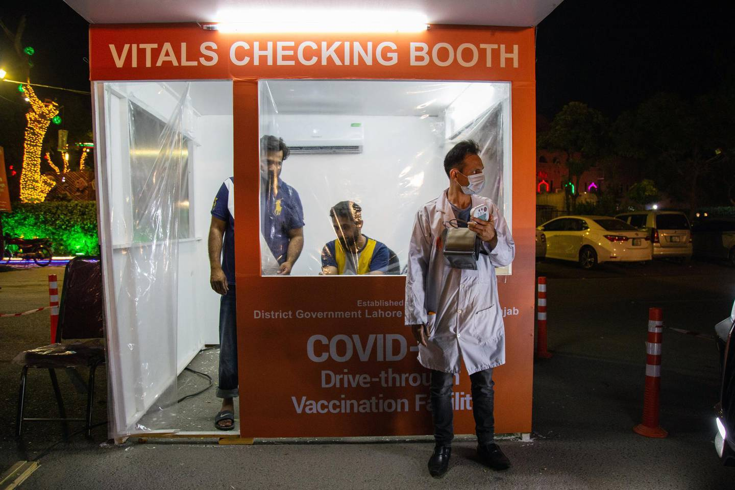 A vitals checking booth at a drive-through vaccination center at Qaddafi Stadium in Lahore, Pakistan, on Thursday, June 10, 2021. Pakistan's Finance MinisterShaukat Tarinwill on Friday find himself walking the fine line between spending big to sustain an economic recovery and keeping the budget deficit in check as the nation emerges from the worst of the pandemic. Photographer: Betsy Joles/Bloomberg