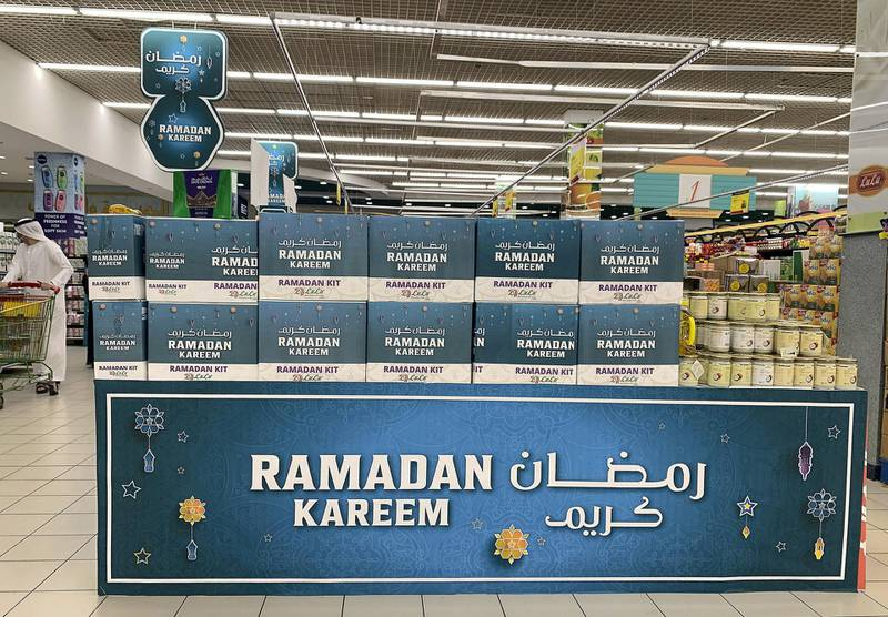 DUBAI, UNITED ARAB EMIRATES , April 20– 2020 :- Ramadan decoration and offers at the Lulu Hypermarket in Al Barsha in Dubai.  Dubai is conducting 24 hours sterilisation programme across all areas and communities in the Emirate and told residents to stay at home. UAE government told residents to wear face mask and gloves all the times outside the home whether they are showing symptoms of Covid-19 or not.  (Pawan Singh / The National) For News/Online