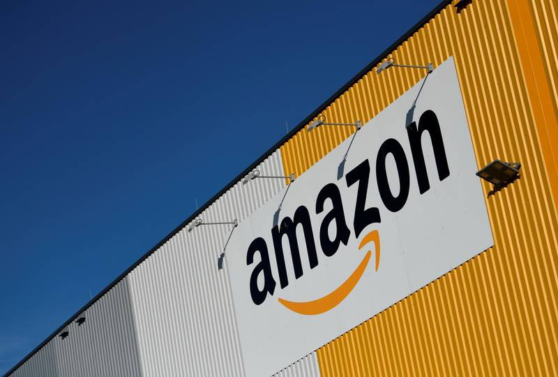 A picture taken on November 8, 2018, shows the logo of US online retail giant Amazon displayed outside the group's distribution center in Dortmund, Germany. (Photo by Ina Fassbender / dpa / AFP) / Germany OUT
