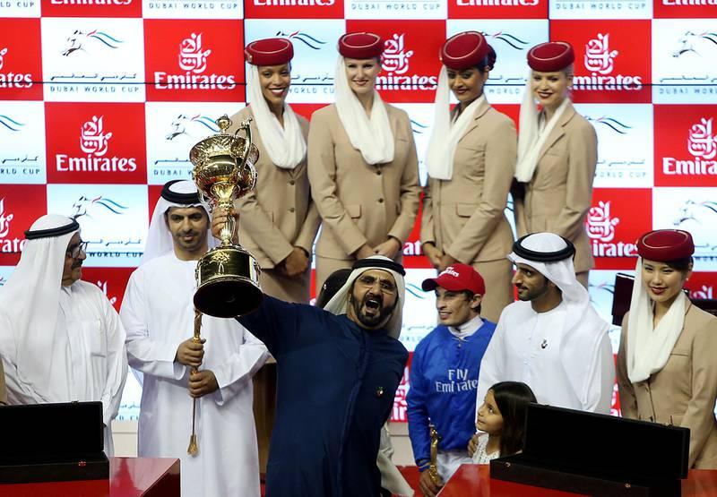 Dubai, United Arab Emirates- March,29, 2014: Sheikh Mohammed Bin Rashid Al Maktoum celebrates after winning  the Dubai World Cup, the world's richest horse race with a prize money of 10 million US dollars in Dubai . ( Satish Kumar / The National )  For Sports