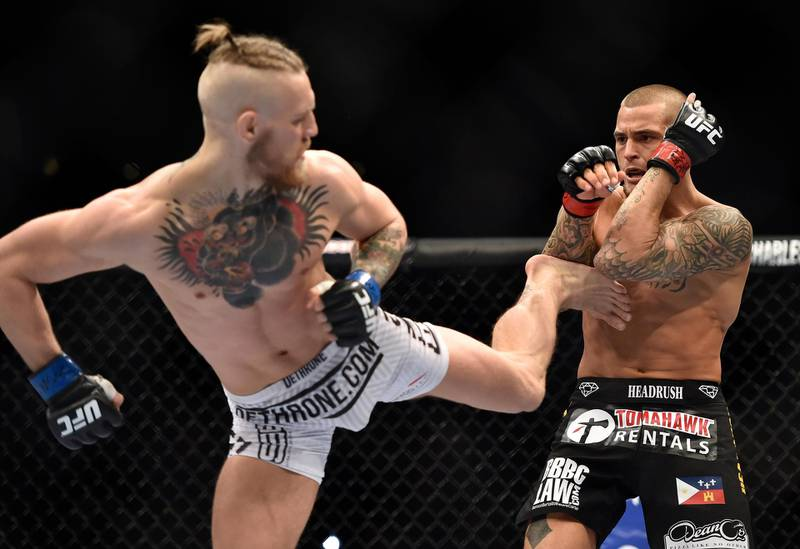 LAS VEGAS, NV - SEPTEMBER 27:  (L-R) Conor McGregor of Ireland kicks Dustin Poirier in their featherweight bout during the UFC 178 event on September 27, 2014 in Las Vegas, Nevada. (Photo by Jeff Bottari/Zuffa LLC/Zuffa LLC via Getty Images)
